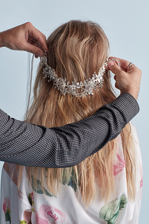 Hair stylist holding crystal belt up to hair
