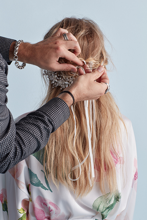 Hair stylist pinning braids