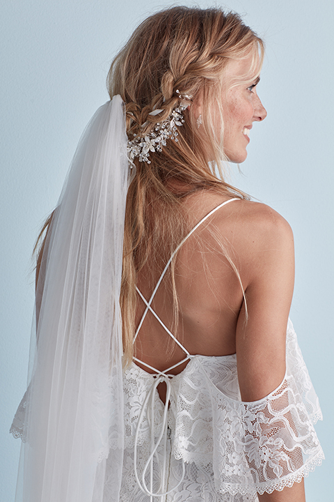 Braided half-up wedding hairstyle with veil