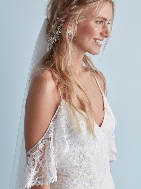Bride with braided half up hair styles with veil