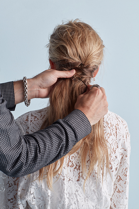 Hair stylist twisting and pinning hair