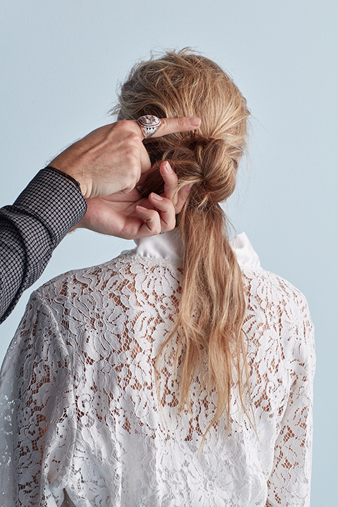 Hair stylist pinning twisted bun