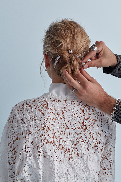 Hair stylist adding pins to bun