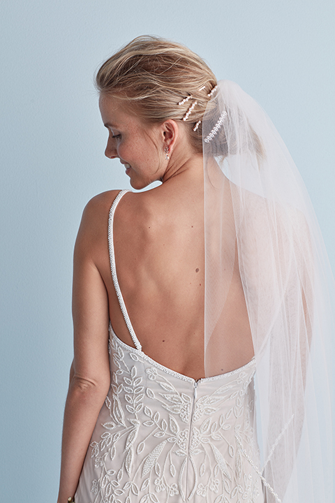 Messy chignon wedding hairstyle with veil