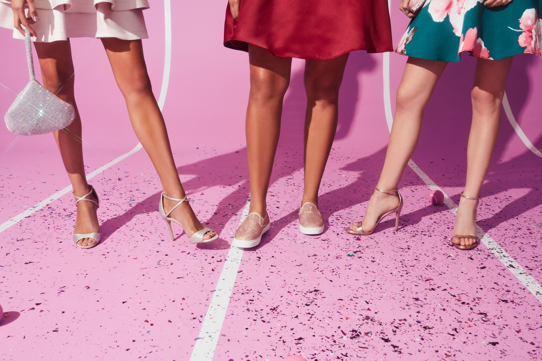 Girls in strappy heels and sneakers for homecoming 2019