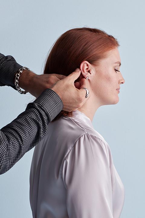 Hair stylist pinning hair
