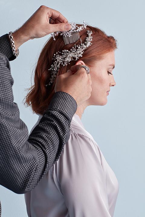 Hair stylist adding crystal hair comb