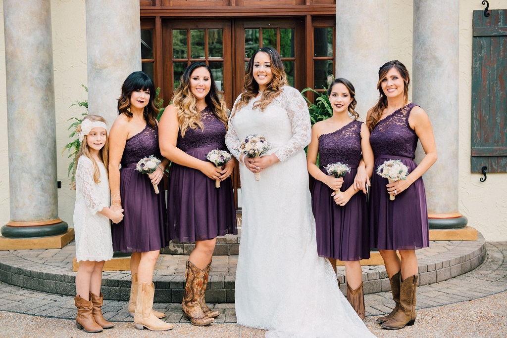 Bride Courtney with her bridesmaids in cowboy boots
