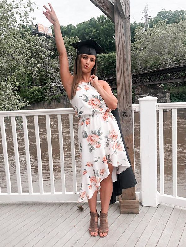 Girl in short flower dress with cap and gown