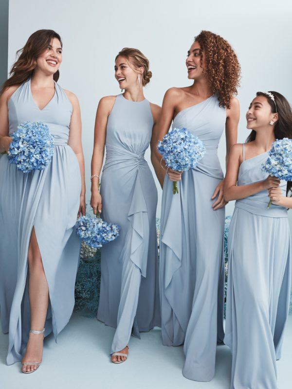 Four bridesmaids in long dusty blue bridesmaid dresses