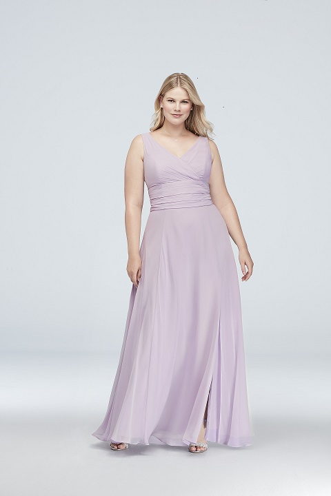 Bridesmaid in a flattering long purple dress with flowy skirt and v-neck