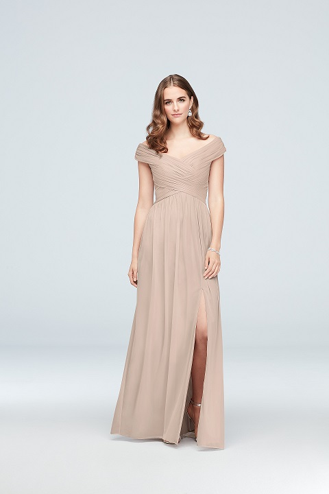 Bridesmaid in long neutral dress with off the shoulder neckline and slit