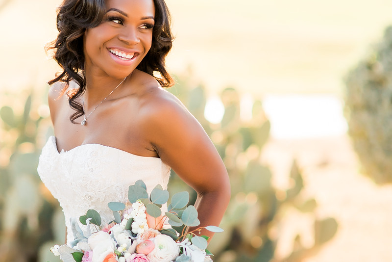 Close up shot of bride Eboni with floral bouquet