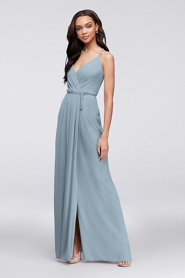 Bridesmaid in a flattering long blue dress with spaghetti straps