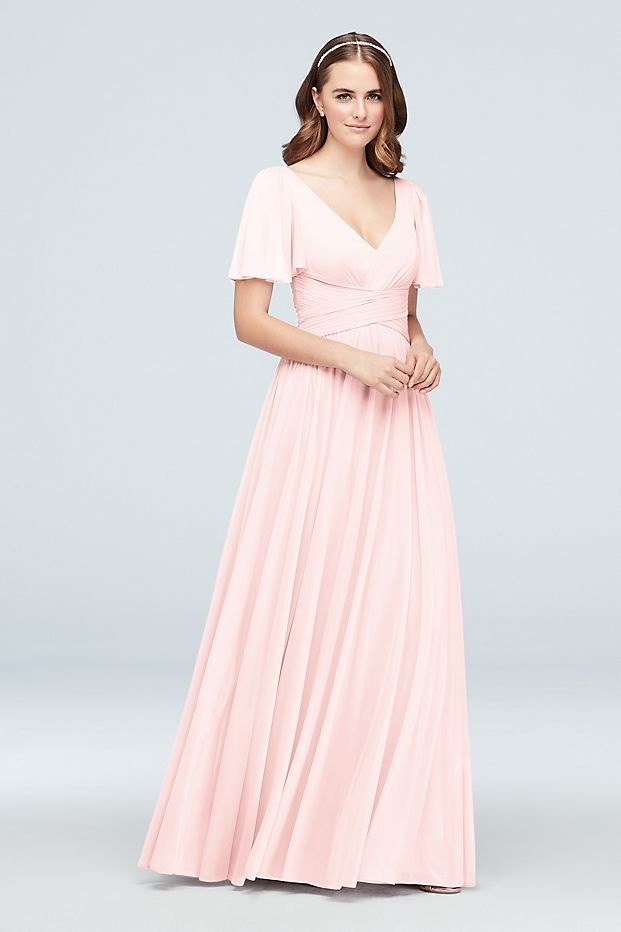 bridesmaid in a flattering long pink dress with flutter sleeves