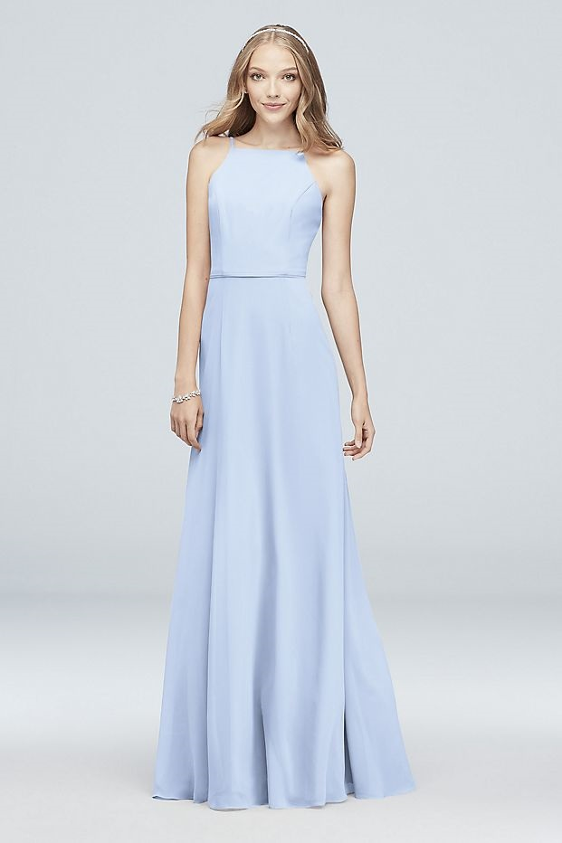 bridesmaid in a flattering long blue dress with high neck
