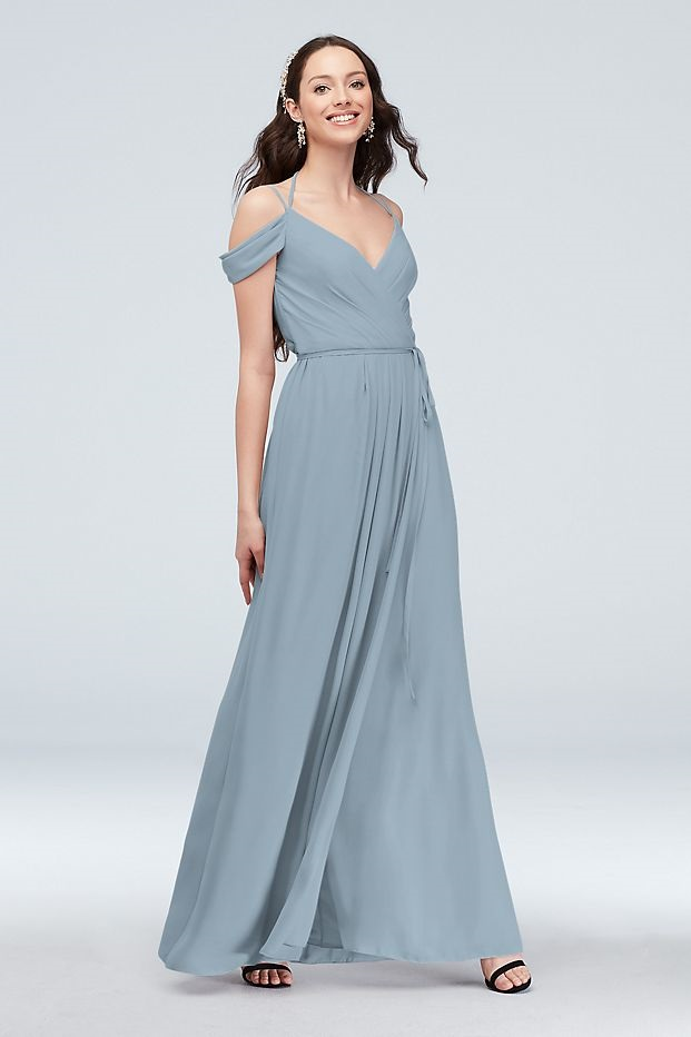 bridesmaid in a flattering long blue dress with cold shoulder top