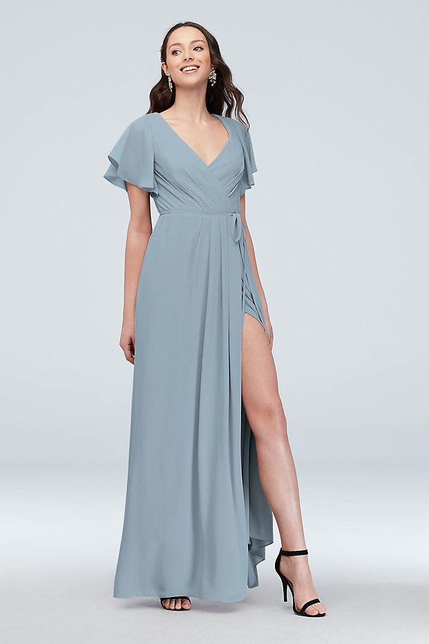 bridesmaid in a flattering long blue dress with flutter sleeve top