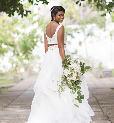Bride in a two-piece wedding dress from behind