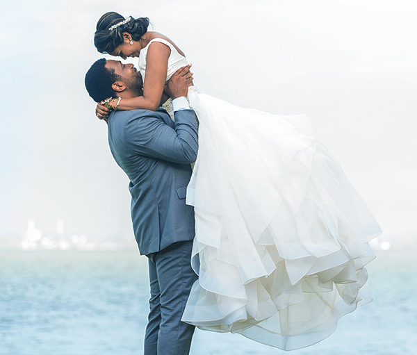 Groom Lifting Bride in two-piece ball gown dress