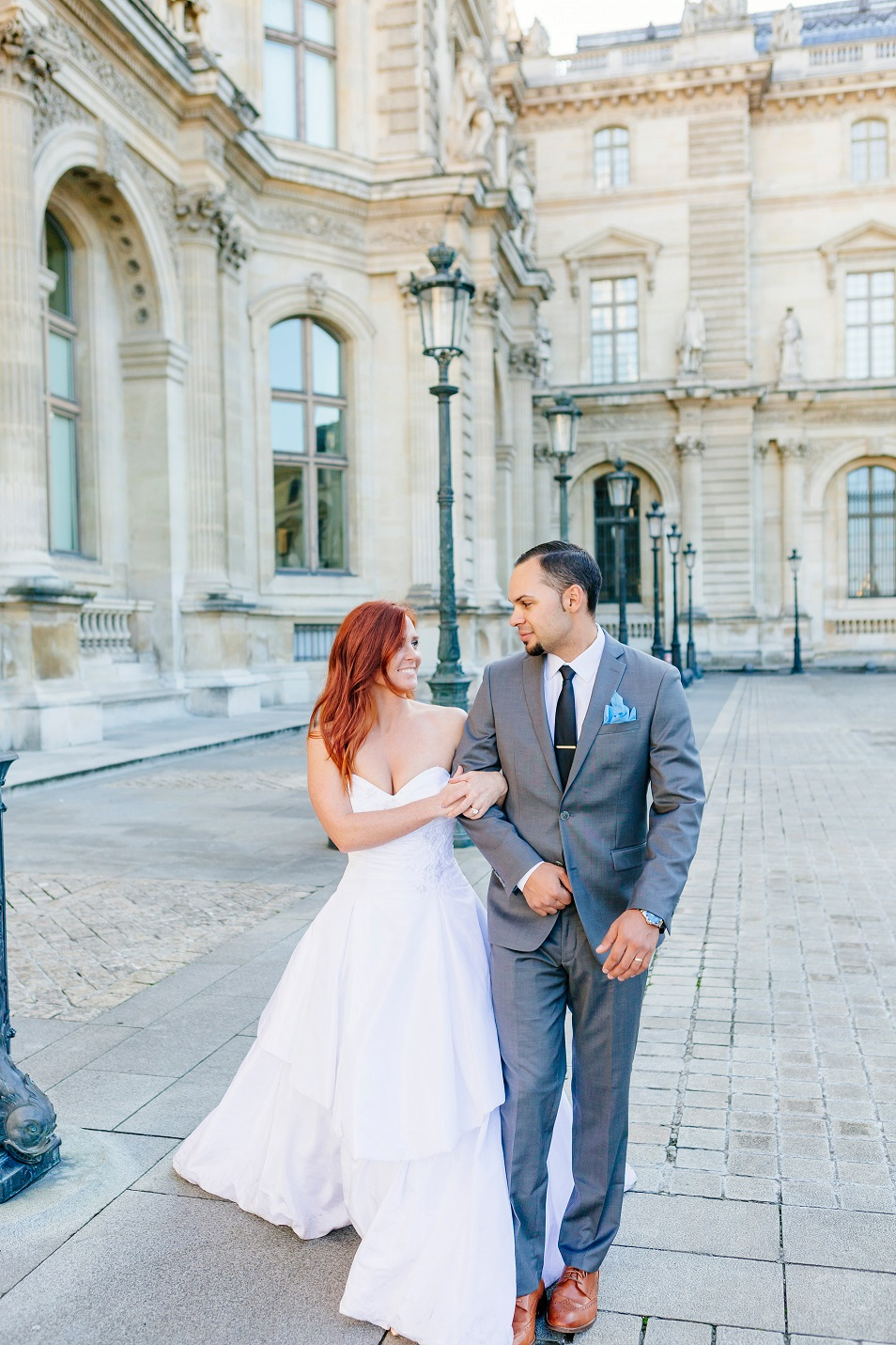 Bride Emily and Groom TJ hold hands in Paris.