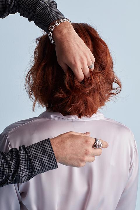 Hair stylist running fingers through hair