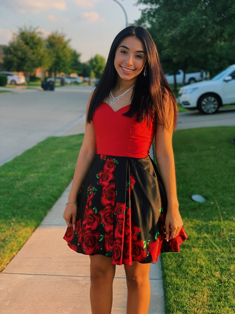 Girl in short red and black rose homecoming dress