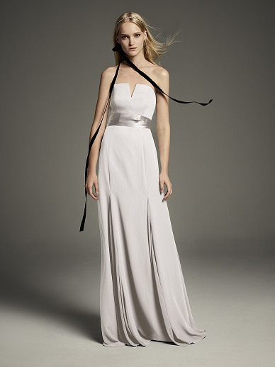Bridesmaid in a flattering long ivory strapless dress with v nocth cut out on bodice