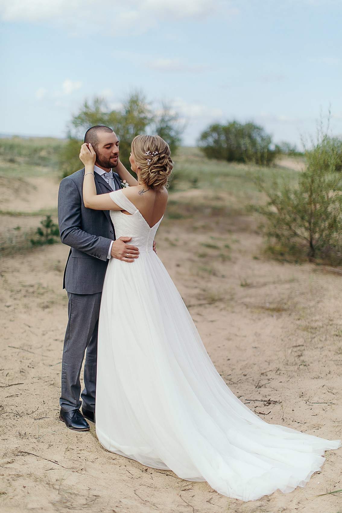 Bride Anna and Groom Levan share a first look moment showcasing the back of the bride's dress