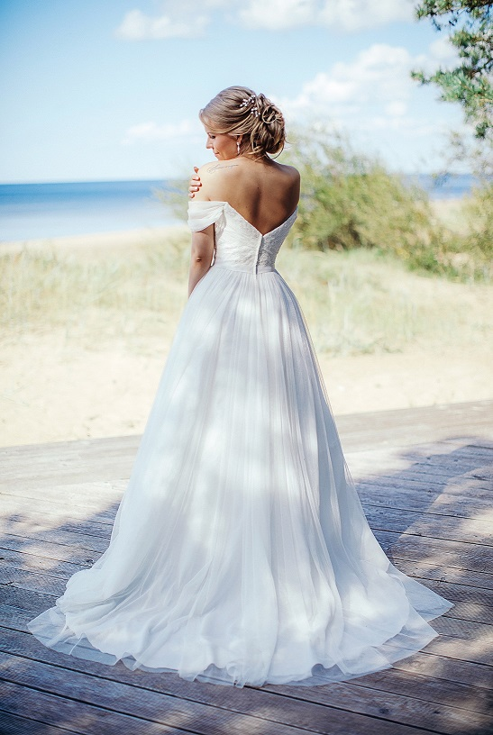 Solo shot of bride Anna showcasing the back of her wedding dress
