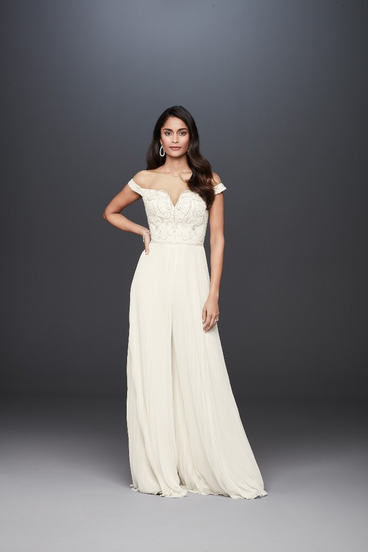 Bride in off the shoulder bridal jumpsuit