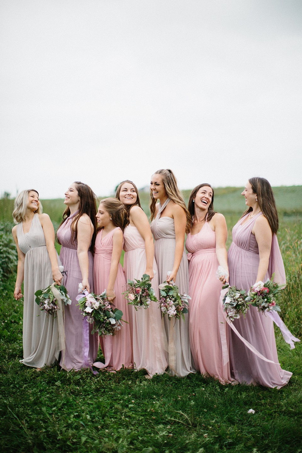 Bride Meghan's bridesmaids in shades of pink and purple