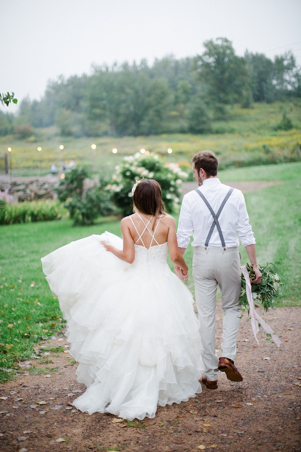 Bride and Groom walking off into the distance