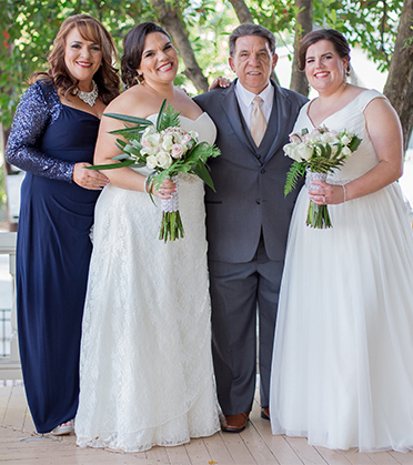 Two brides with their parents.