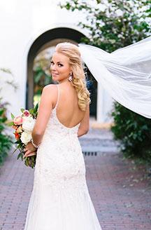 Nicole posing for wedding photos.