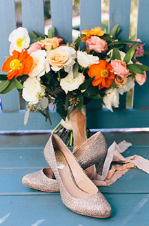 Nicole's bouquet and shoes on display for wedding photos.