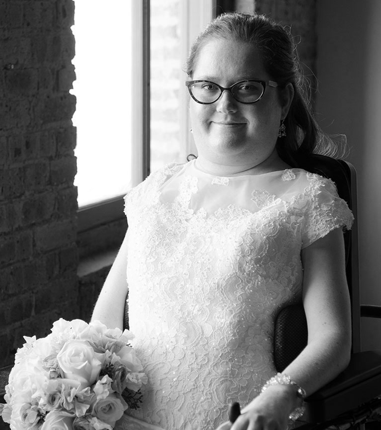 Bride seated holding a bouquet