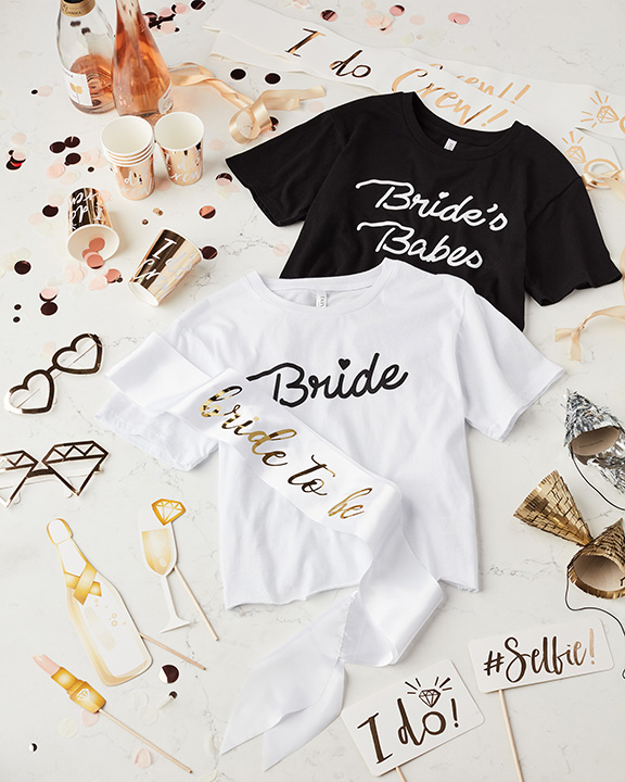 Black and white bachelorette tee shirts and photo props
