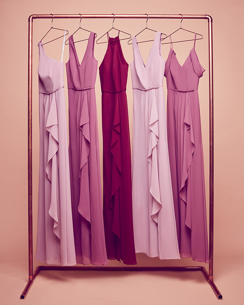 Bridesmaid dresses hanging on a rack