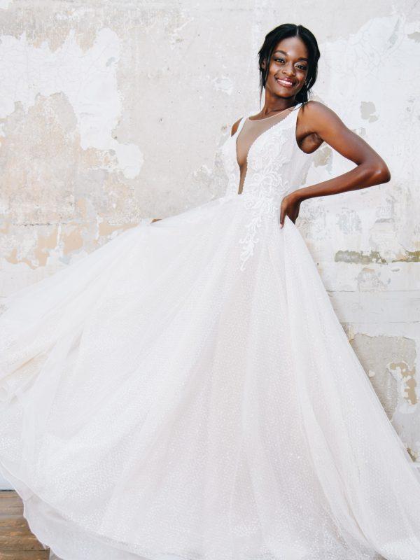 Bride in long plunging neckline wedding dress