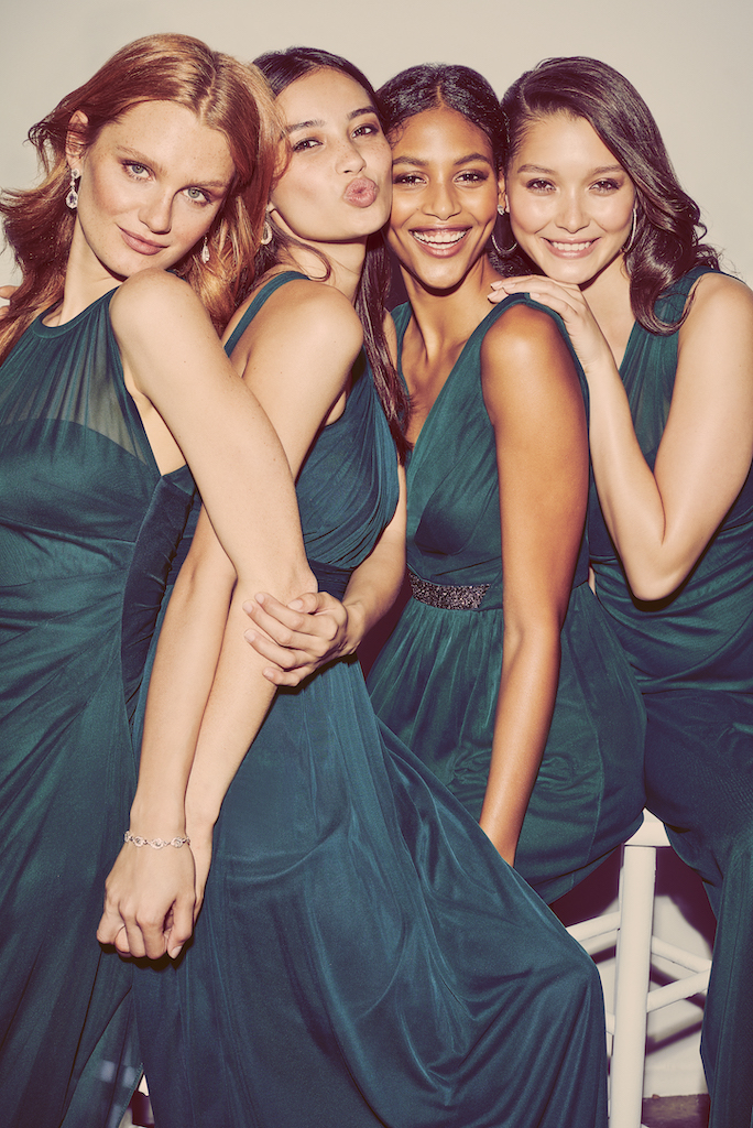 four bridesmaids in jewel tone dresses for a winter wedding color palette
