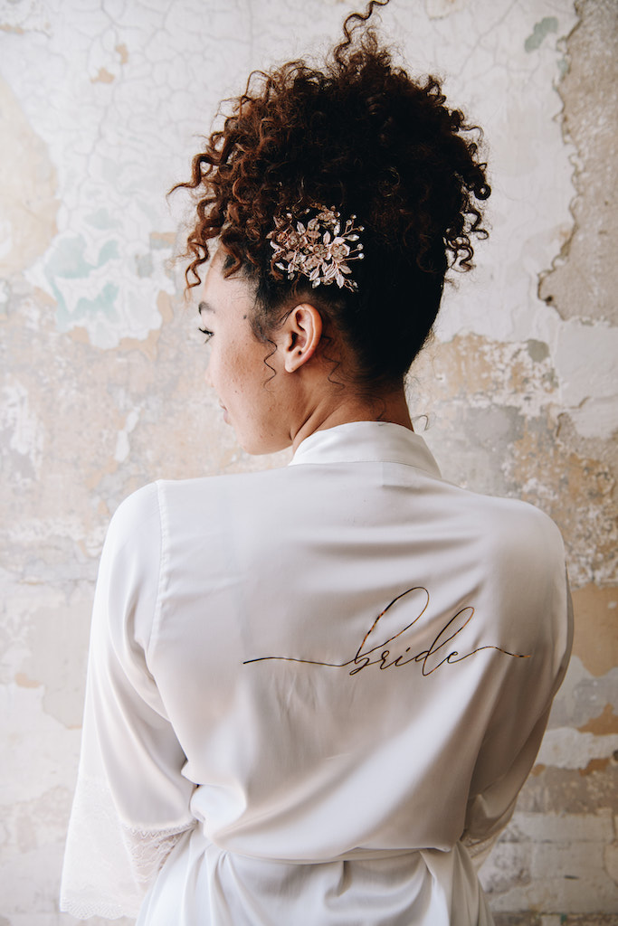 Bride with high up-do for curly hair