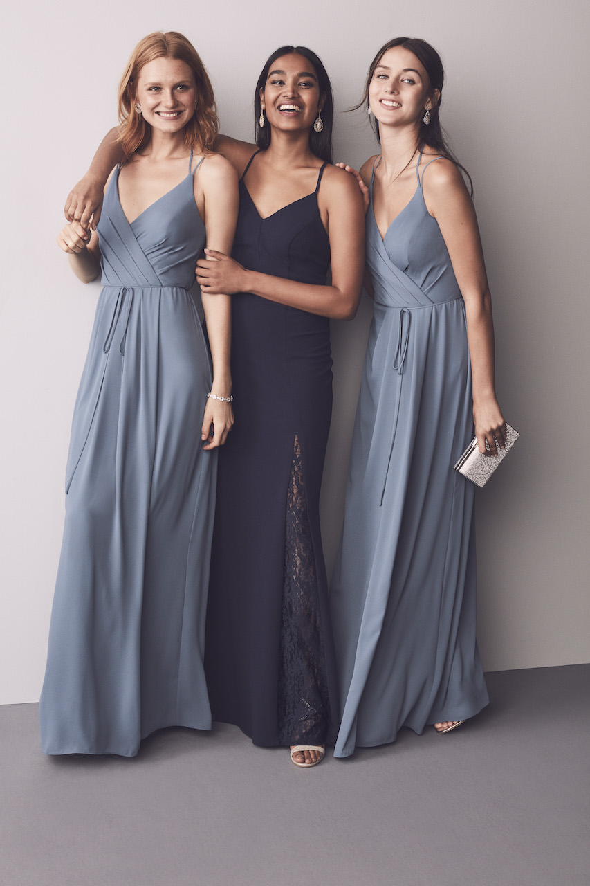 Three bridesmaids in mix and match long blue dresses