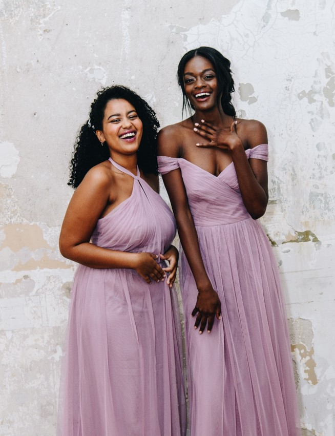 two bridesmiads in long quartz colored dresses