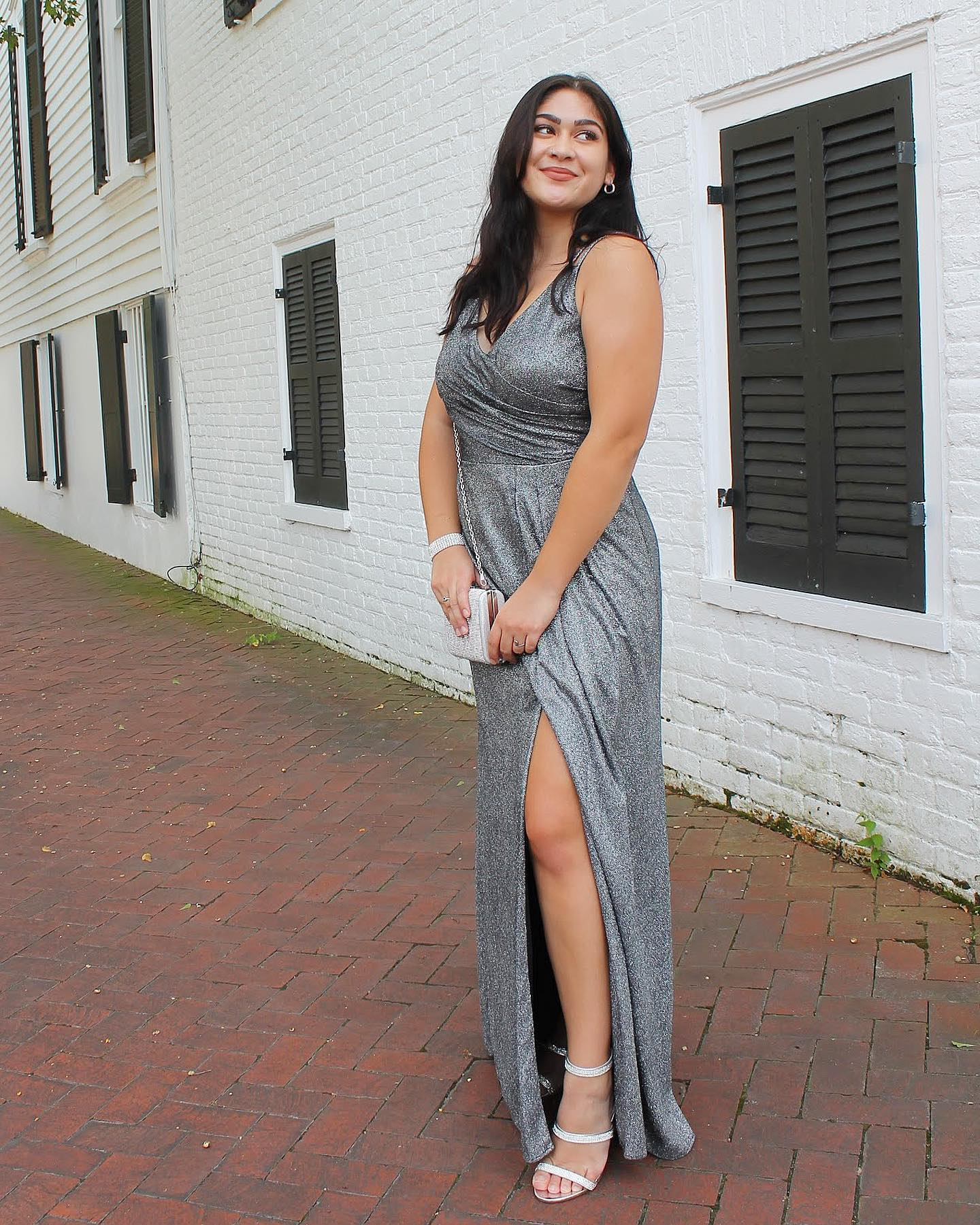 College Ambassador wears long silver David's Bridal dress