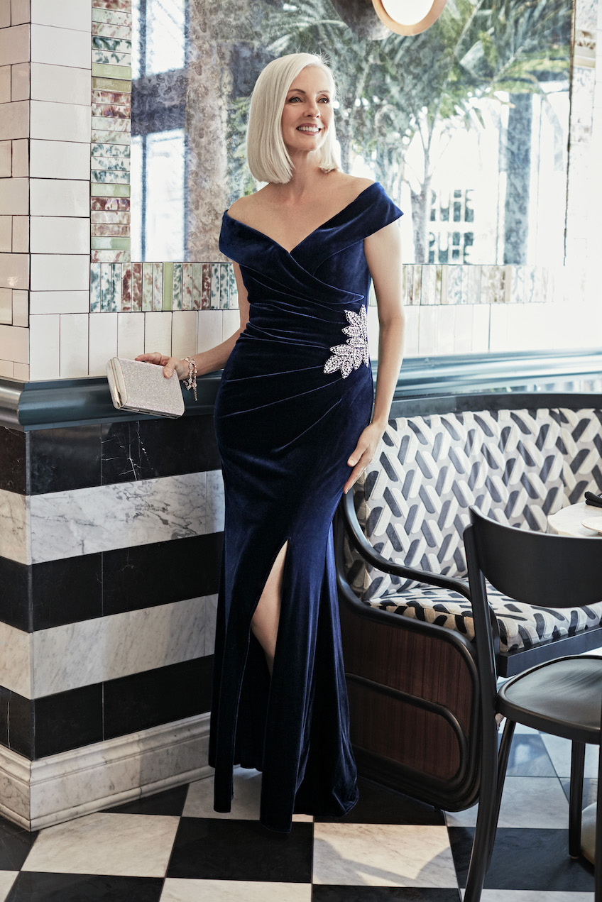 Mother of the bride in a long velvet off the shoulder dress