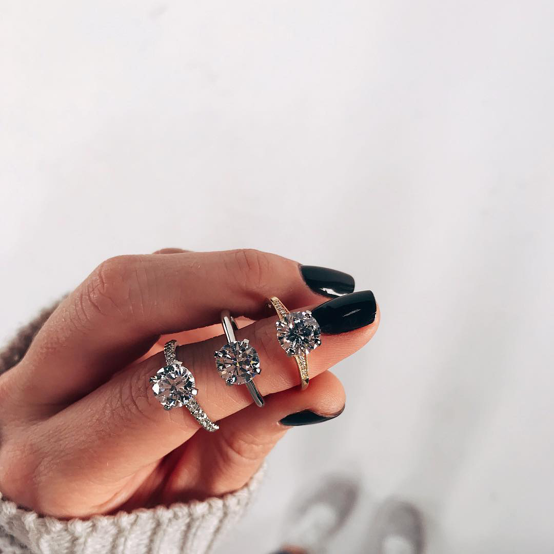 Stack of diamond rings on finger