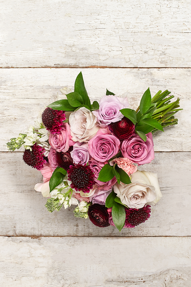 Pink and burgundy wedding bouquet featuring berry colored Scabiosa flowers.