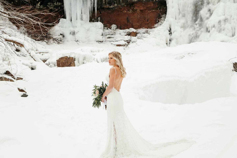 Solo bride shot on snowy landscape