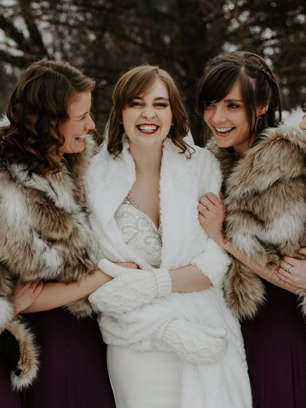 embracing snow on your wedding day bridal party